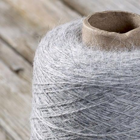 C102 Silver coloured cone yarn