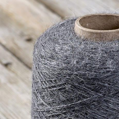 C109 Dark Grey yarn on the cone
