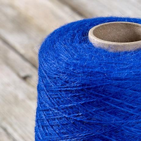 C219 Bright blue cone yarn